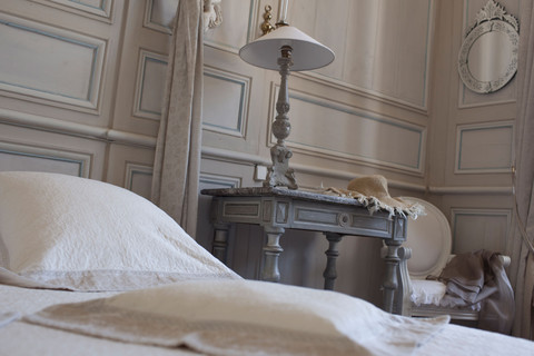 Bed and nightstand of the Diane Room in the Château de La Ballue