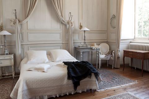 Bedroom with a canopy bed at the Chateau de La Ballue Brittany Mont Saint Michel